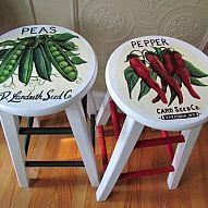 Vintage seed packet art painted onto old bar stools.