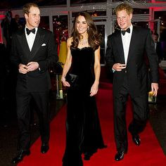 "Wearing a stunning black Alexander McQueen gown, the Duchess of Cambridge is joined by Prince William and Prince Harry at the ""A Night of Heroes"" awards ceremony at London's Imperial War Museum on Monday."