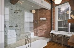 """brick and marble     This Photo has 3 Questions:  """"Shower, tub & faucet fixtures? - Can you please give the brand and style of the plumbing fixtures? Thanks so much!""""  1 · 3 weeks ago  """"Who makes this sink?""""  3 · 9 months ago  More »"""