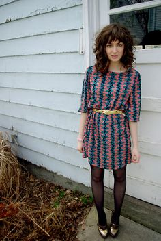 Really love this look. messy, textured bangs with big curls. cute outfit.