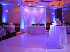 This backdrop and uplighting centers your guests attention on the wedding sweet heart table!