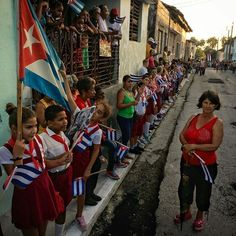 Photo by @dguttenfelder  Cubans line the roadside as they wait for the funeral procession of Fidel Castro to pass through the small town of Esperanza, Cuba this evening in the way to the far eastern city of Santiago. For more photos from Cuba please follow @dguttenfelder and our upcoming @natgeo Instagram story.