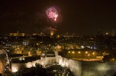 Fireworks light up the sky over Jerusalem during the  celebration of Israel's 62nd anniversary on April 19, 2010. After six decades of struggle, it  still remains a city of exalted dreams and unresolved national ambitions.