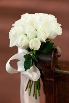 Sweet wedding isle decor. Floral design: Winston Flowers. Photo credit: Ned Jackson.