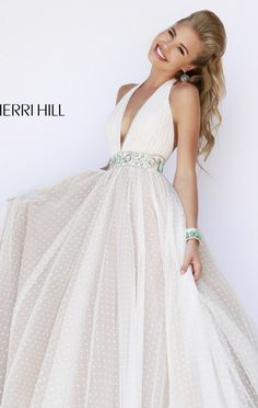 Glam up your event in Sherri Hill 11250. This enchanting evening gown features a halter neckline. This dress is trimmed with an open back design that is flattering to your sultry appeal. The fitted waist is trimmed with beaded band that gives an attractive look. The skirt is long and gives a romantic full-length finish.