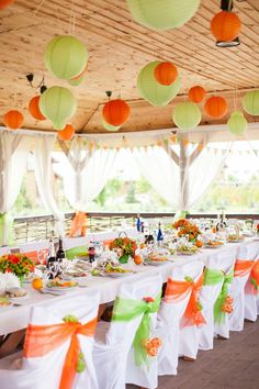 Green and orange are perfect wedding colors for fall weddings. Paper lanterns are great wedding decorations!