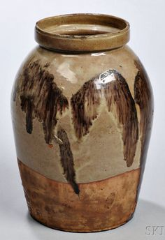 Skinner's - The Personal Collection of Lewis Scranton, Auction 2897M. May 21, 2016. Lot: 147.  Estimate: $1,500-3,000.  Realized: $2,100.   Description:  Redware Jar, possibly Alfred, Maine, 19th century, ovoid with gray glaze and manganese splotch decoration, ht. 7 1/2, dia. 5 1/2 in.