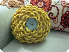 DIY crochet flower pillow. Gorgeous!