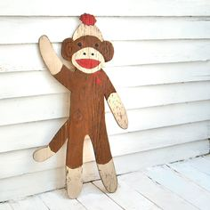 Large, rustic sock monkey sign. Would love this for the baby's room!