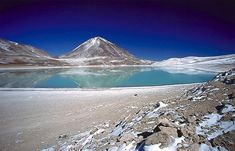 """Nevado Ojos del Salado (""""Source of the Salt river"""" summit) is a massive stratovolcano in the Andes on the ARGENTINA-CHILI border and the highest volcano in the world at 6,893 metres (22,615 ft)"""