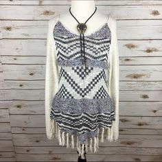 "[American Rag] Boho Fringe Sweater Aztec Tribal Fun patterned sweater. Lightweight knit. Wide neckline. Pointed hem with fringe. Neutral color way. Looks great with skinnies.   Fabric: 84% Cotton 8% Acrylic 8% Rayon Bust: 17"" Length: 29"" including fringe Condition: NWT!  No Trades! American Rag Sweaters"