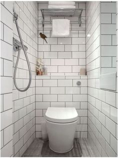Design ideas for a traditional bathroom in London with white tiles, metro tiles and a one-piece toilet. — Houzz White tiled walls with grey floor tiles — Xiu Jin Kooi