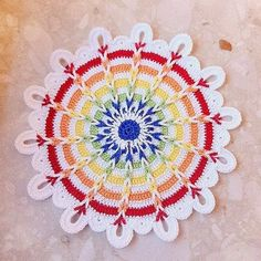 Mazourka-Iris  : Rainbow Crochet doily.. I would love to make these for table mats.They are s.o.o pretty,and there's a free pattern and tutorial for making!!