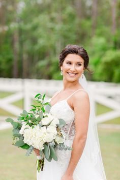 This bride's lace illusion wedding dress paired with her fresh white and greenery peony bouquet was a beautiful combination at Tringali Barn near Jacksonville, Florida. | Nikki B Photography