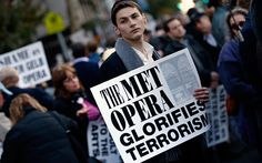 """Sign: """"The Met Opera Glorifies Terrorism""""  On 12/11/14, the community Arts Against Aggression published an open letter in which they requested the Metropolitan Opera cancel all future performances by Anna Netrebko, an opera diva that recently handed 1M rubles into the hands of the leader of militants that with the regular Russian army have embroiled Ukraine's Donbas in a war that has  claimed the lives of around 11,500 people."""