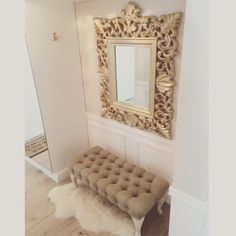 Golden mirror and bench in entryhall