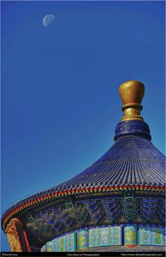 The moon over the roof of the Temple of Heaven, Beijing. The Ming Dynasty masterpiece was created using wood only and boasts rich and colorful decorations. On tour through Beijing the impressive display of Chinese craftsmanship and culture is not to be missed. #DarrellLew http://djlewphotography.com/
