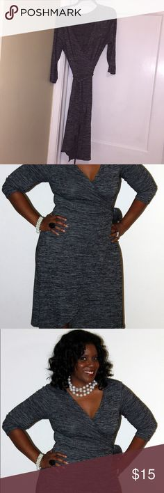 Black and white wrap dress Plus size black and white wrap dress gently worn. Rayon, polyester and spandex blend, resulting in a nice stretch. Dresses