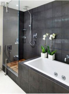 Tiles around bath continued from shower Image flipped to match our layout