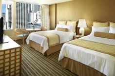 Queen Kapiolani's City View Guest Rooms offer comfortable accommodations 1/2 block from Waikiki Beach #Hawaii #Waikiki #AquaHotels