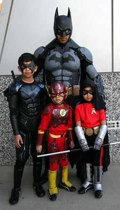DC Comics heroes Batman, Nightwing, Flash, and Robin, mostly as seen in the video game Batman: Arkham City