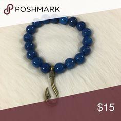 Handmade Fish Hook Bracelet Handmade various sized fishhook stretch bracelet with blue glass beads. Jewelry Bracelets