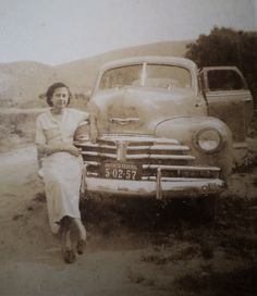 Dolores Duran - Brasil - Brazilian Pop - Adileia Rocha circa 1949, sitting on the bumper of an American Chevrolet automobile. Irley Rocha, Adileia's baby sister says they used to live in Caxias-DF, on a street with only four or five houses on each side. At the end of the street there was this clearing where future Dolores Duran poses for a snapshot.