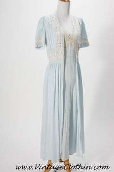 1940's peignoir set by Tula.  Baby blue in color with ivory eyelet lace detail around the sleeves, and bust area on the coat, bust and shoulder area on the nightgown.   A quality peignoir set in fantastic shape for its age.  This would best fit a size extra small or small may fit a medium at a push.   http://shop.vintageclothin.com/1940s-Tula-Peignoir-Set-VC1111.htm  #1940snightgown #Nightgown #Peignoirset  #1940 #1940s  #vintage #vintageclothin.com  #Forsale #buyme #peignoir #Tula