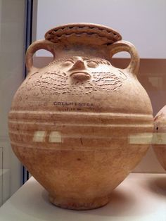 Face-Urn, Roman Britain, British Museum. 2nd century AD. Colchester. These are vessels of specialised, non-domestic use. The large urn is a container for cremated bones.