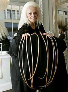 World's Longest Fingernails Broken In Car Crash  Lee Redmond held a Guinness World Record for the longest fingernails at a combined 30 feet. Fortunately for us, but unfortunately for her, the disgusting claws were broken in a car accident on Tuesday.     Lee Redmond had not cut her nails since 1979, making Wolverine's claws look like a child's toy. According to Guinness, her nails were last measured on August 8, 2006 with her thumbnail measuring the longest at 2 feet, 11 inches.