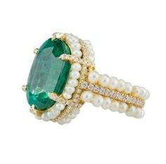 From Al Zain Jewelry: A halo of pearls trails down the shank in two rows of this yellow gold ring, featuring a 15.24 ct. oval-shape emerald center stone with 9.15 cts. t.w. pearls and 0.91 ct. t.w. diamond accents. by Eva