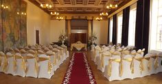 Chair Covers with a Gold Sash at Brangwyn Hall by Emma Hall Designs