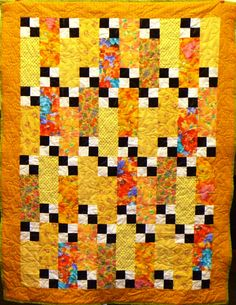 A cheery Four Patch Frenzy kit quilt.