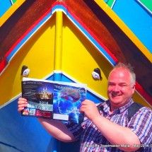 Mgarr harbour, Gozo: The eyes of Osiris on a Luzzu (highly painted Maltese fishing boat) read the Toastmaster Magazine