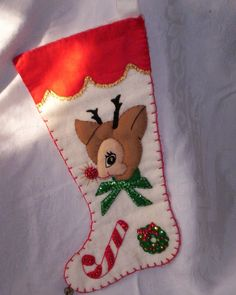Vintage stocking...My lifelong girlfriends mom made me one allot like this. I still have it and would not part with it. I still hang it each year.