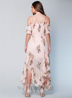 Country Field Maxi Dress. A gorgeous cocktail dress by We Are Kindred. A floral print dress featuring frilled off shoulder sleeves and flirty asymmetric skirt.