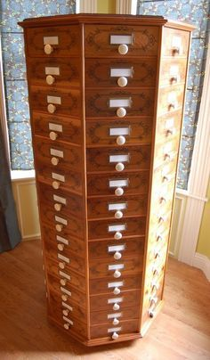 WOW would have been awesome in yellow in my room with crystal green knobs    Rotating Bolts Bin - Bing Images
