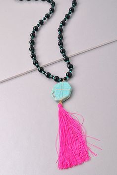 Tickle Me Pink Necklace only $26! This long necklace is so amazing you will want to wear it everyday! The turquoise stone with the long pink fringe tassel is so beautiful!