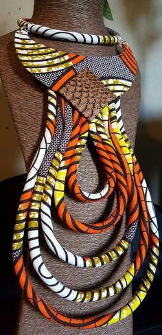 Très beau collier Makeda en wax                              …