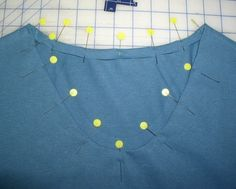 How to alter the neckline of a basic t-shirt to make it more feminine. www.laurassewingstudio.com