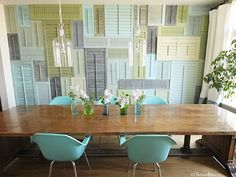 A collage of old shutters turns a featureless wall into a focal point