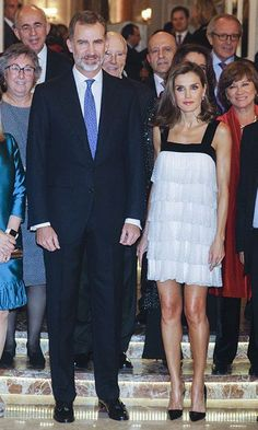 All eyes were on Queen Letizia when she stepped out in Madrid on 23 November to attend the journalist awards ceremony Francisco Cerecedo, with King Felipe. The royal looked gorgeous in a monochrome flapper-style number, which showed off her toned legs. Letizia's dress – which was embellished with glittery sequins – featured thick black velvet straps, and was identified by website Queen Letizia style as a 2008 Teresa Helbig design