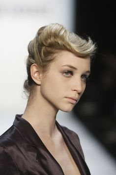 Pin for Later: Retro Runway: The Best Vintage-Inspired Hair and Makeup Looks  At the Autumn/Winter 2010 Stefan Eckert show, models sported a modern take on the victory roll, with a quiff-like flick thrown in for good measure.