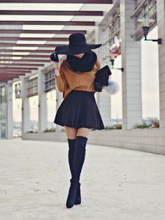 big black hat, black snood, jumper tucked in black pleat skater skirt, stuart weitzman highland boots