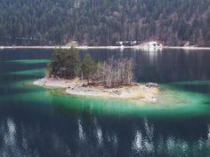 Next summer, we need to swim to that little island.  http://bit.ly/eibsee-4 #eibsee #bavaria #wanderlust #lake #island #mountains