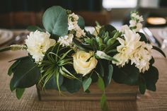 simple centerpieces with white flowers and greenery