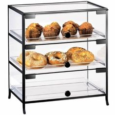 This Display case features a clear acrylic look with a black iron accent. Its front triple doors will go great in any bakery, coffee shop, breakfast setting or market, making it sim Bakery Display Case, Bread Display, Pastry Display, Wood Display, Display Cases, Display Ideas, Cafe Display, Cupcake Display, Countertop Display Case