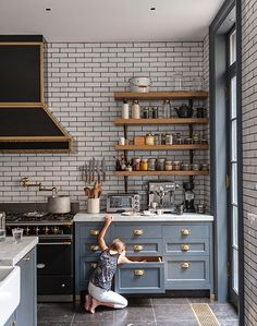 Kitchen Decor Idea using subway tiles and black grout. Perfect with the charcol blue cabinets. I love the mix of materials and colours in this kitchen. The black rangehood works beautifully with the charcoal grout on the subway tiled splashback. Kitchen Interior, New Kitchen, Kitchen Dining, Kitchen Decor, Kitchen Cabinets, Teal Cabinets, Kitchen Layout, Cupboards, Kitchen Ideas