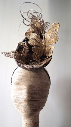 Gold toned fabric covered headpiece trimmed with gold butterflies