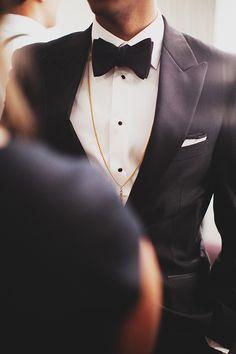 Love the look of a sharp, crisp tux on the groom.Photo by Erik Clausen | via junebugweddings.com